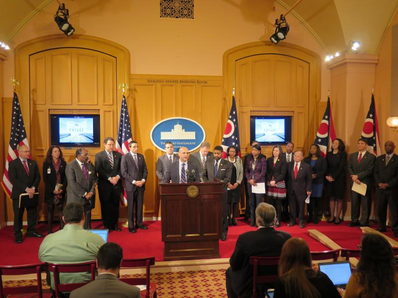 Senate Minority Leader Joe Schiavoni (D-Boardman) and House Minority Leader Fred Strahorn (D-Dayton), surrounded by members of the House and Senate Democratic Caucuses