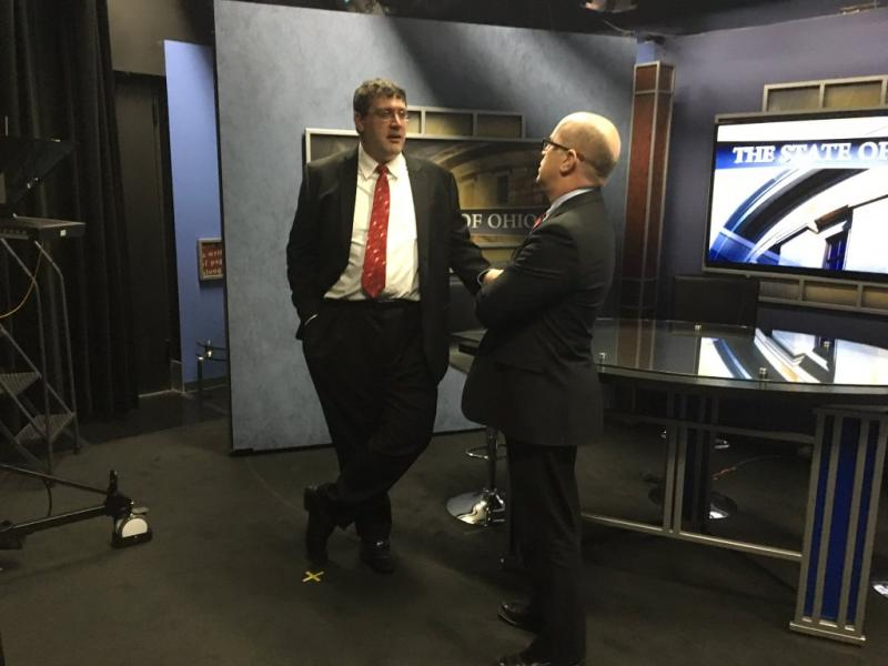 "The Buckeye Institute's Greg Lawson (l) and John Corlett from the Center for Community Solutions chat after a taping of ""The State of Ohio""."