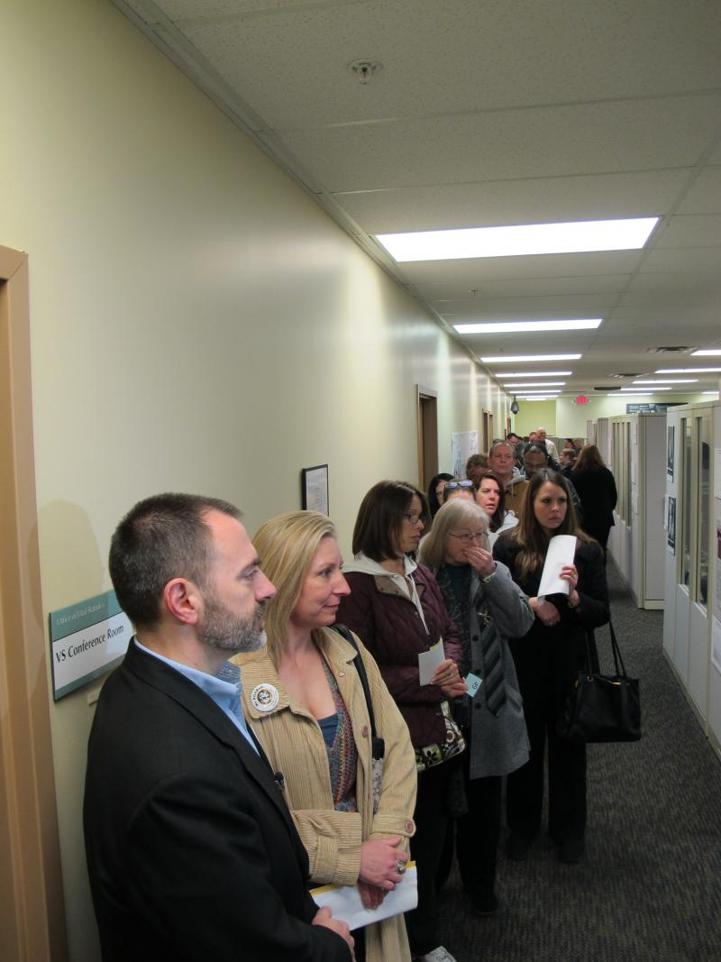 Adoptees line up on the first day they can file paperwork to get their adoption records.