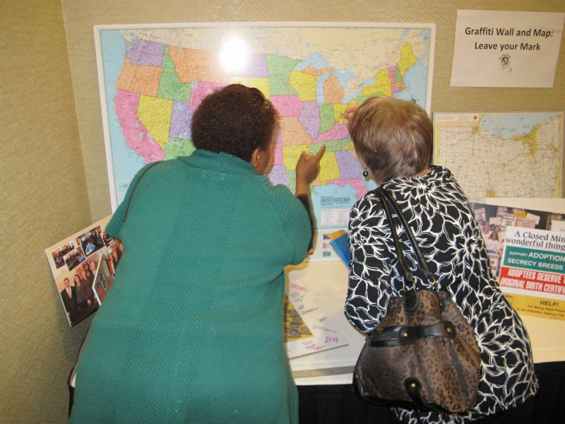 Adoptees note their current homes on a US map the night before they file for their adoption records in Ohio.