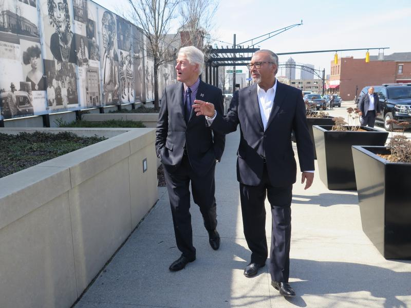 Former President Bill Clinton walks on the Long Street bridge over I-71 with former Columbus mayor Michael Coleman.