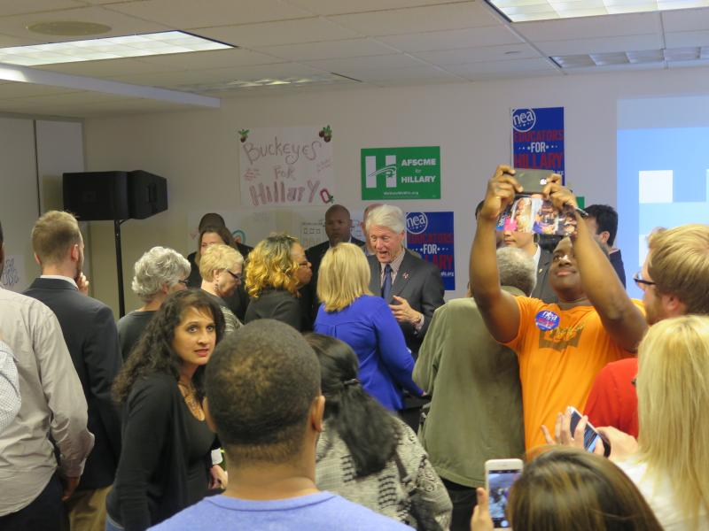Former President Bill Clinton greets supporters at the Hillary For Ohio campaign headquarters in Columbus.