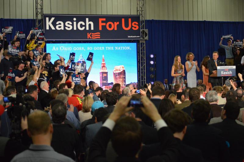 Gov. John Kasich's supporters greet the presidential candidate after winning the Ohio primary during a rally in Berea