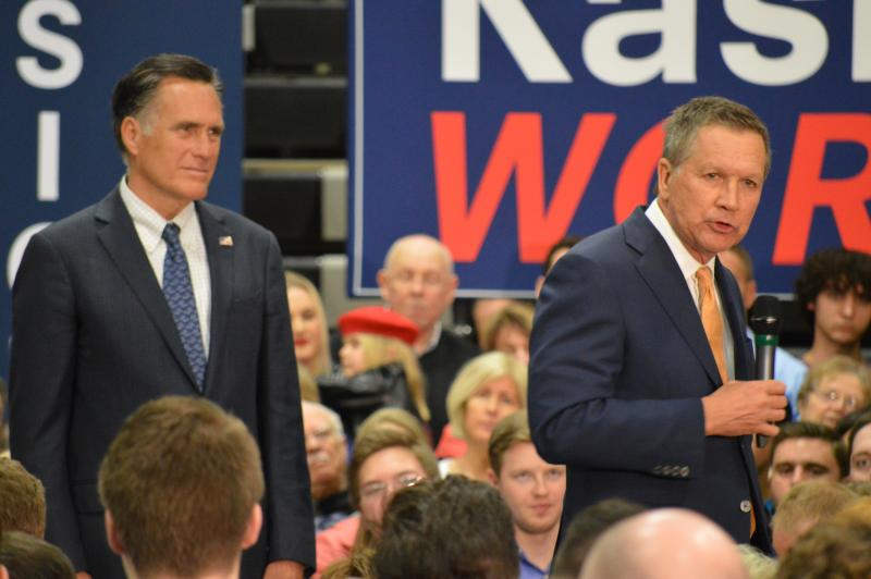 Gov. John Kasich and former GOP presidential nominee Mitt Romney at a rally in Westerville