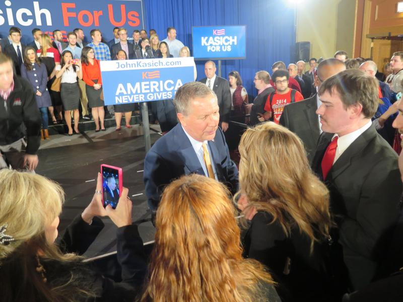Gov. John Kasich greets supporters after remarks at the Michigan watch party.