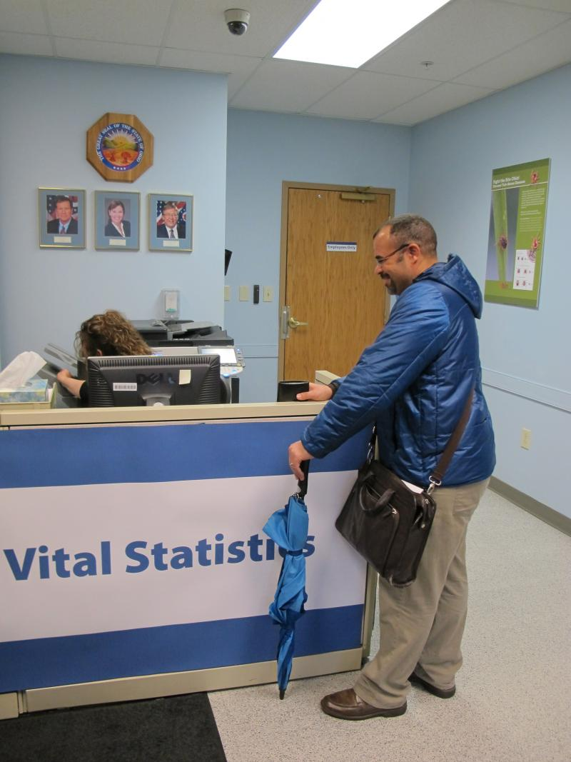 Mike Thayer checks in before applying to get his adoption records.