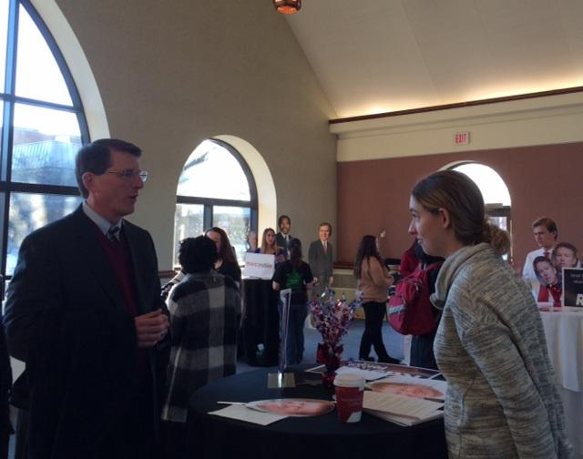 "Emily Feldmesser - ""Gov. John Kasich"" at the speed dating event - peaks with OWU President Rock Jones."