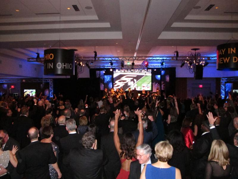 Republicans at Gov. John Kasich's inaugural ball celebrate a Buckeyes touchdown. The game was shown on big-screen TVs at the black-tie event.