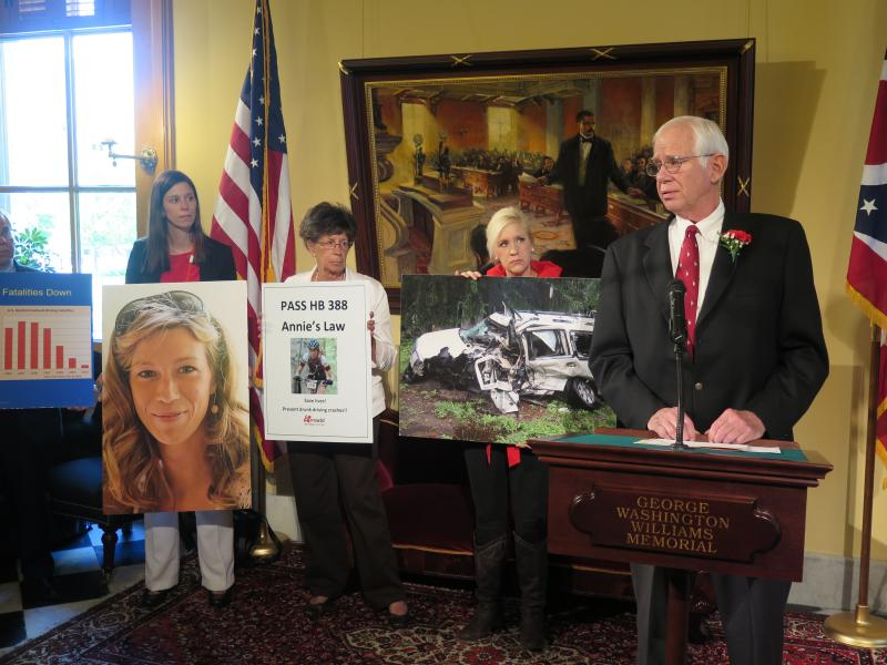"Dr. Dick Rooney (right) stands with his wife and family members at event urging passage of ""Annie's Law""."