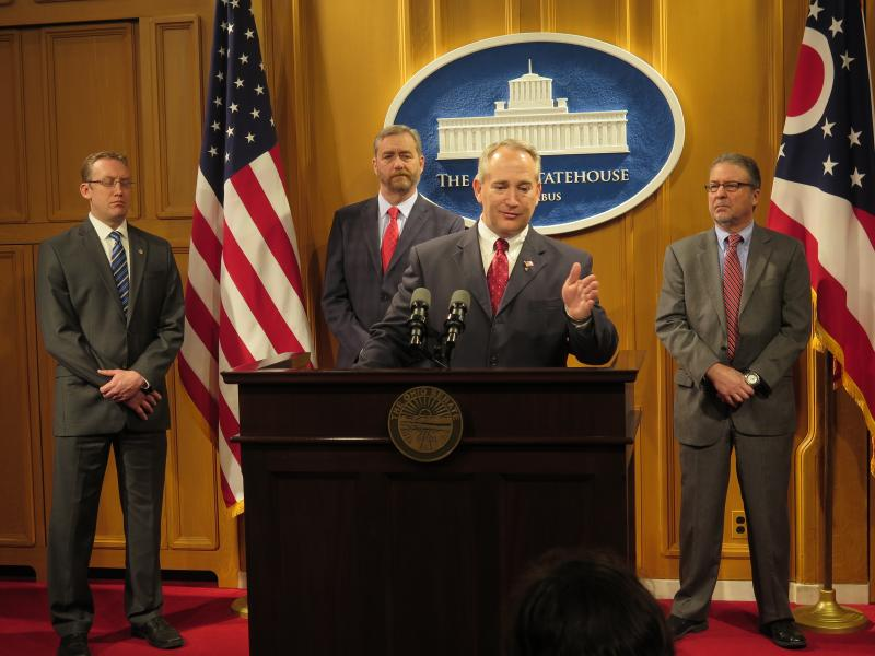 Senate President Keith Faber, surrounded by advocates of the new public records law, speaks to reporters in April 2016