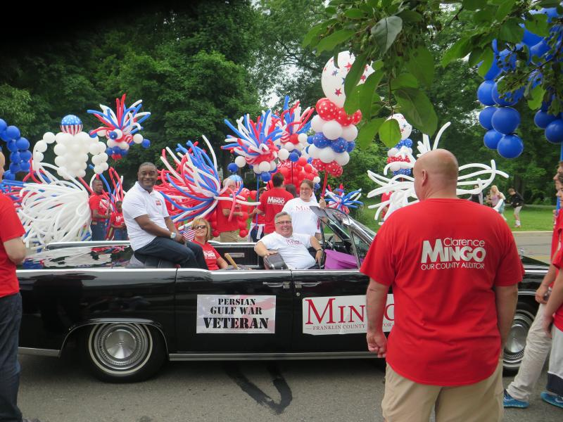 Franklin County Auditor Clarence Mingo rides in Westerville's Fourth of July parade.