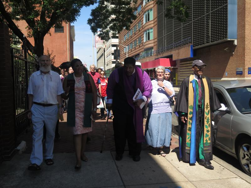 Faith leaders start their march from the Friends Center to the DNC offices.