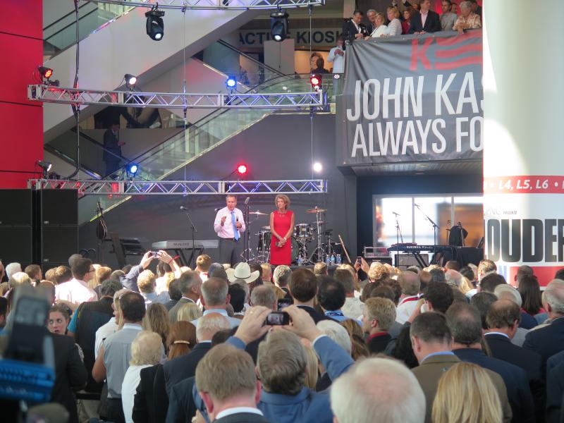 Gov. John Kasich and his wife Karen Kasich appear before supporters at a reception at the Rock and Roll Hall of Fame in Cleveland.