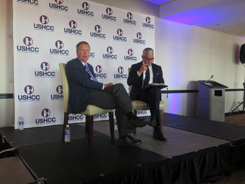 Gov. John Kasich talks with Javier Palomarez of the US Hispanic Chamber of Commerce at the Powerhouse in Cleveland.