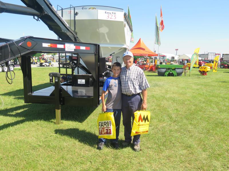 Dave Kreis and his grandson attend the Farm Science Review.