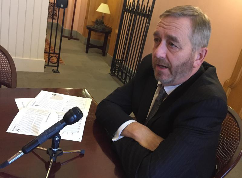 Auditor Dave Yost explains his office's report on open enrollment in his office at the Ohio Statehouse.