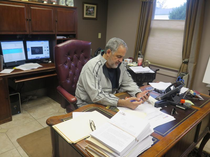 Mahoning County Democratic Party chair David Betras is back at work in his law office in Canfield.