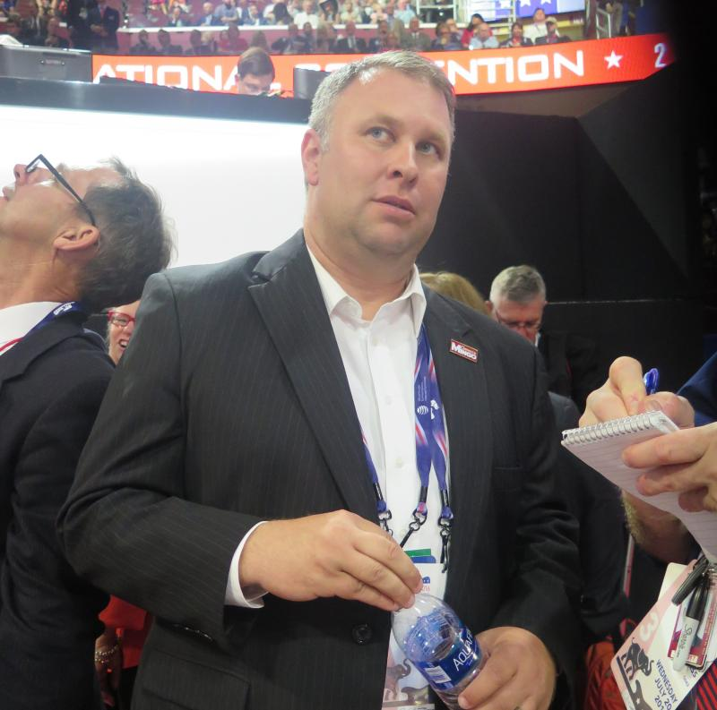 Ohio Republican Party Chair Matt Borges talks to reporters on the floor at the RNC in Cleveland in July.