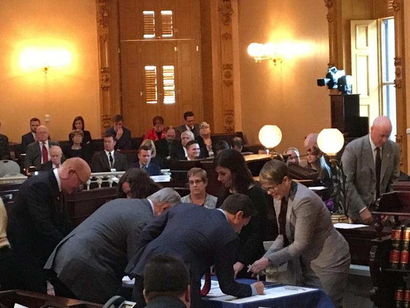 Ohio's 18 electors sign their votes.