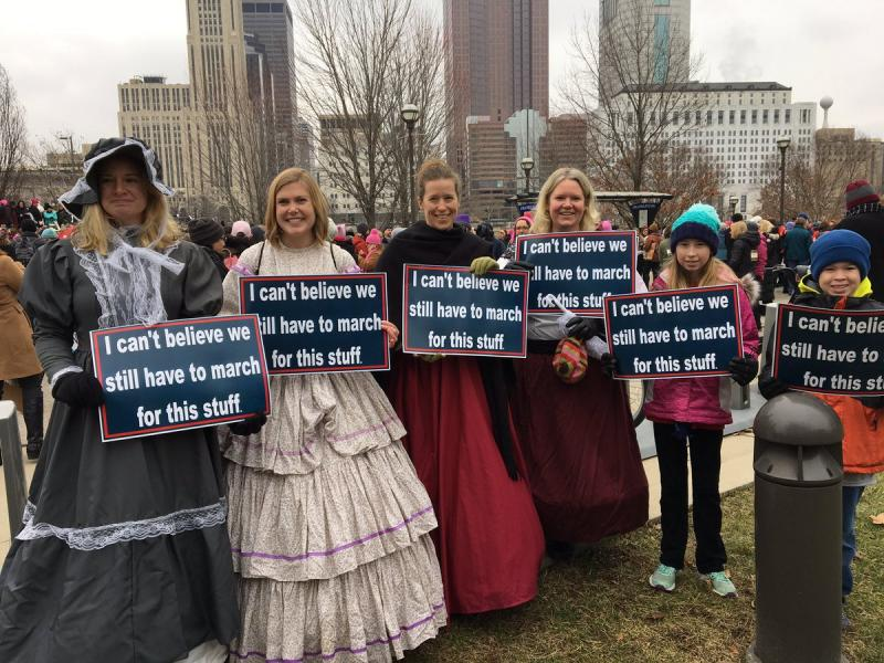 Women in costumes participate in the Women's Sister March.