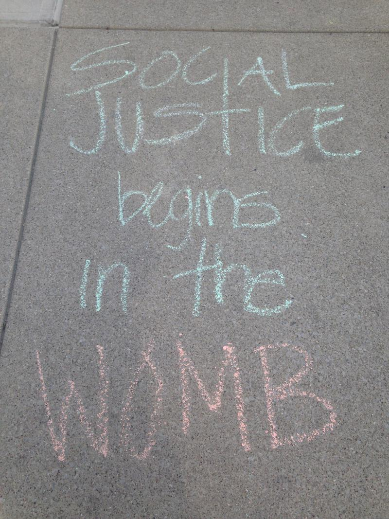 A chalk drawing outside an Ohio Department of Health hearing on a Dayton abortion clinic in April 2016.