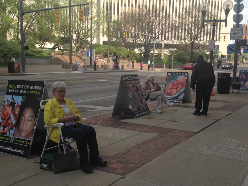 Anti-abortion protestors demonstrate outside an Ohio Department of Health hearing on a Dayton abortion clinic in April 2016.