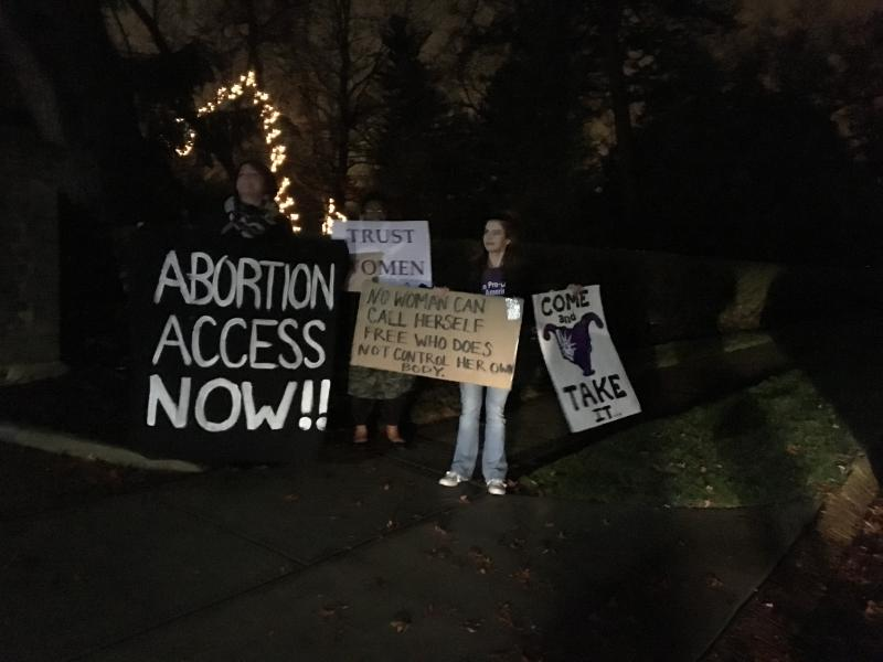 "Abortion rights protestors demonstrate outside the Governor's Residence as lawmakers debate the ""heartbeat bill"" and a 20 week abortion ban."