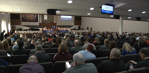 Hundreds sit inside the sanctuary of Fellowship Baptist Church in Columbus to discuss and share ideas on how to fight the opioid epidemic.