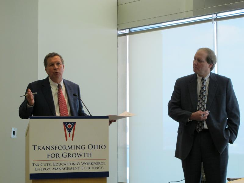 Gov. John Kasich (left) and OBM director Tim Keen at a budget announcement in 2012.