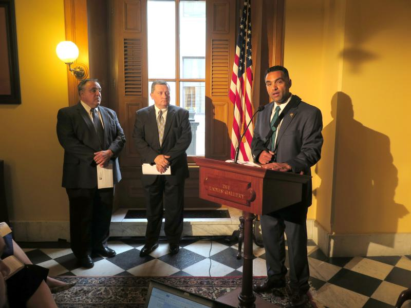 "Rep. Nino Vitale (R-Urbana, at podium) is joined by evangelical Christian leaders as he speaks about his ""Pastor Protection Act"" in May 2016."