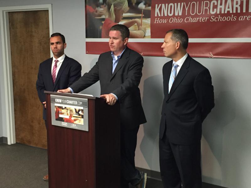 Charter school critics including former Rep. Steven Dyer (center) speak out.