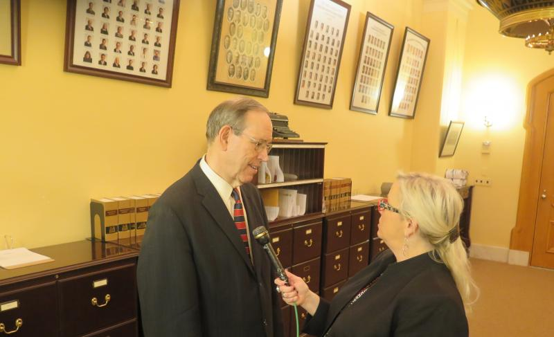 Former Governor Bob Taft speaks with reporter Jo Ingles