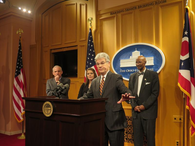 Sen. Matt Huffman (R-Lima), Rep. Christina Hagan (R-Alliance) and Rep. Bill Patmon (D-Cleveland) stand behind former U.S. Rep and U.S. Sen. Tom Coburn (R-OK) at a Statehouse press conference.