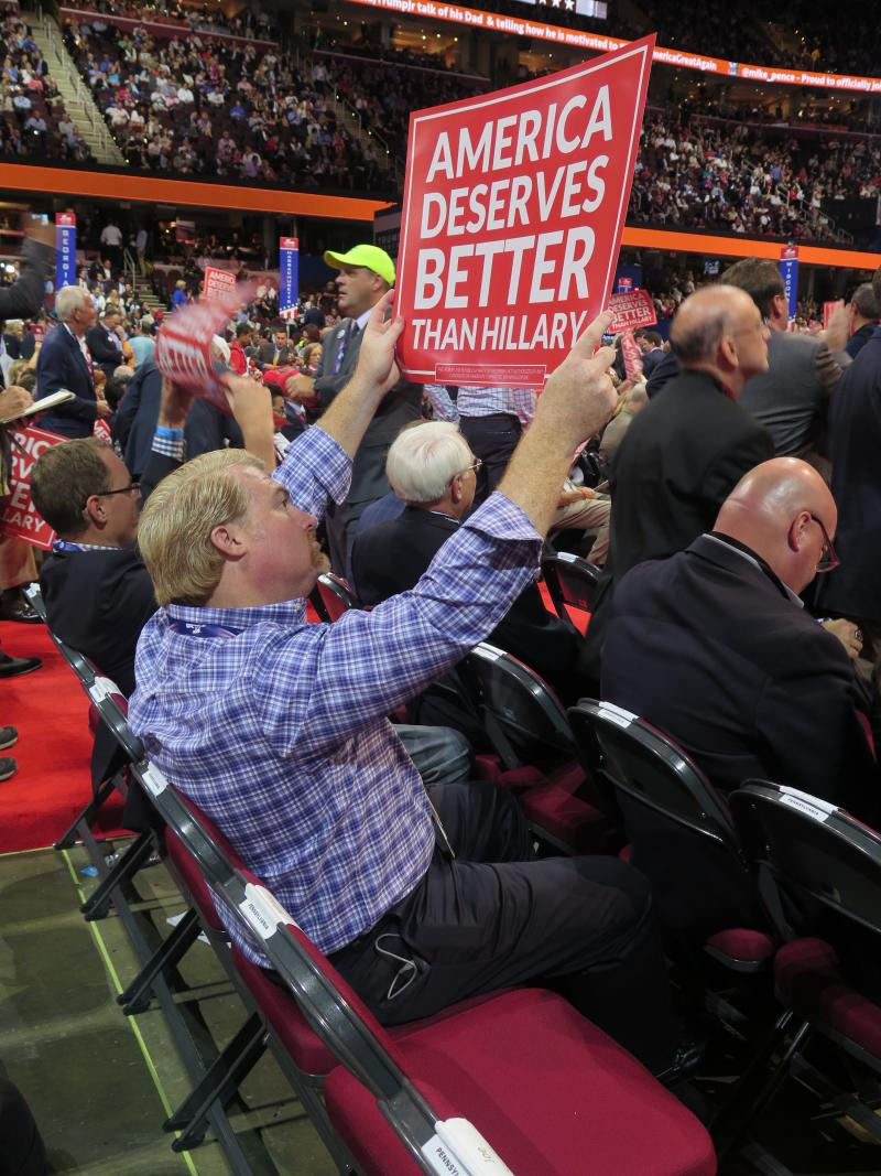 Pennsylvania delegate Mark Scaringi holds a sign on the floor of the RNC.