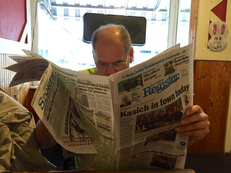 Lacy Hamilton, who's lived in Sandusky for 50 years, reads the paper at his regular breakfast spot, Better Half Diner, the morning Gov. John Kasich and state leaders head to town.