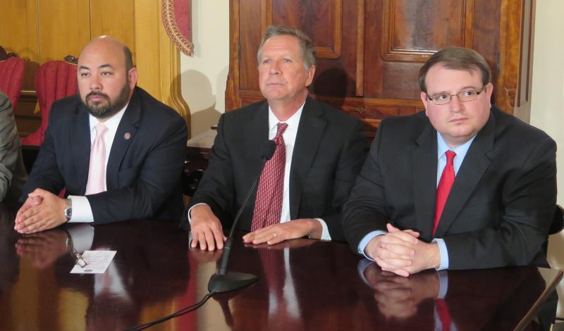 House Speaker Cliff Rosenberger (R-Clarksville), Gov. John Kasich and Senate President Larry Obhof (R-Medina) appear together for Kasich's budget cutback announcement