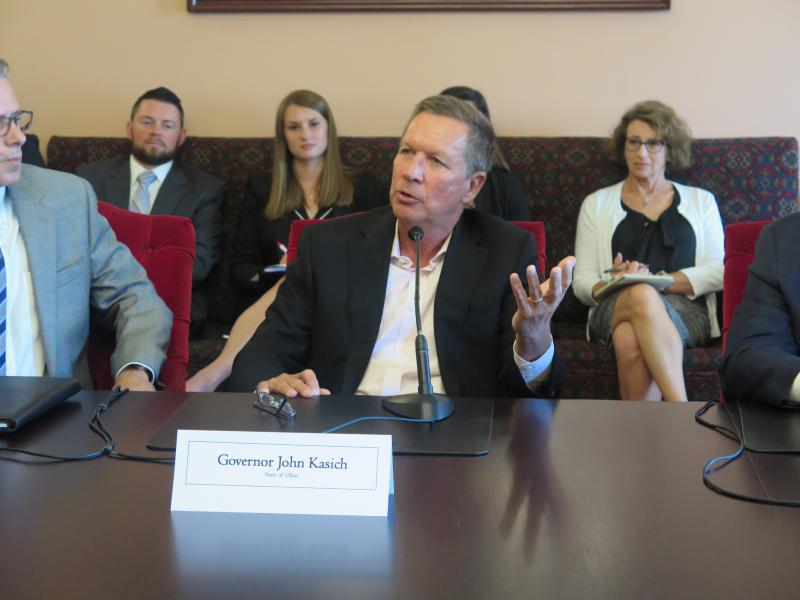 Gov. John Kasich said he wouldn't talk about the budget as he met with insurance industry leaders.