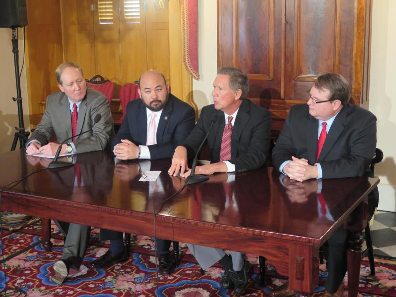 Budget director Tim Keen (far left), House Speaker Cliff Rosenberger (R-Clarksville), Gov. John Kasich and Senate President Larry Obhof (R-Medina) announce in April the budget needed to be cut by $800 million.