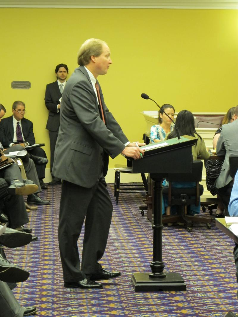 Budget director Tim Keen testifies before the House and Senate conference committee in 2013, the year the small business tax cut passed.