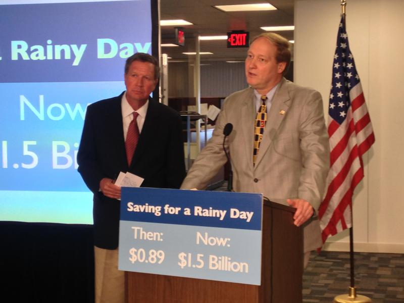 Gov. John Kasich and OBM Director Tim Keen make a transfer into the state's rainy day fund in 2013.