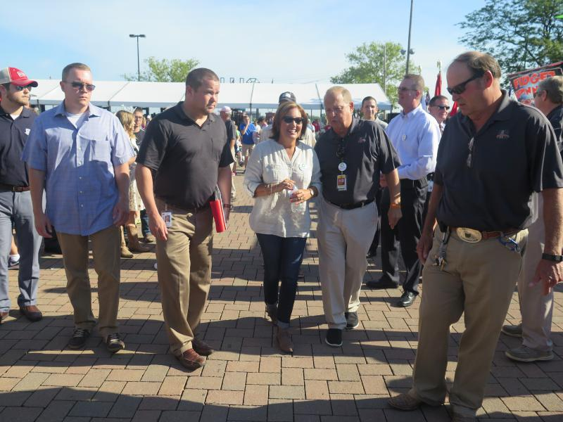 Lt. Gov. Mary Taylor tours the Ohio State Fairgrounds with fair general manager Virgil Strickler after opening the 164th Ohio State Fair Wednesday morning.