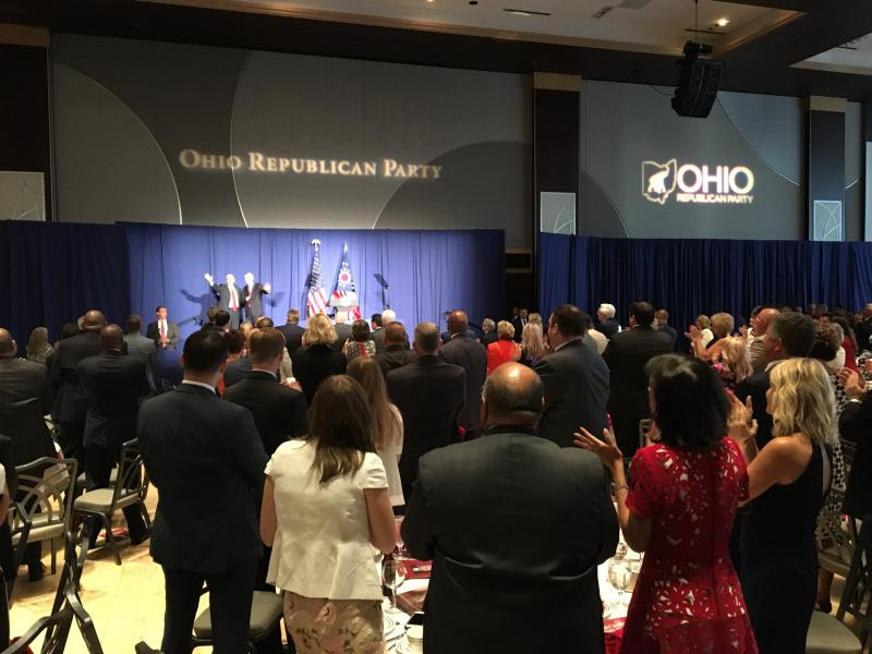 Vice President Mike Pence and U.S. Sen. Rob Portman share the stage briefly at the annual Ohio Republican Party state dinner.