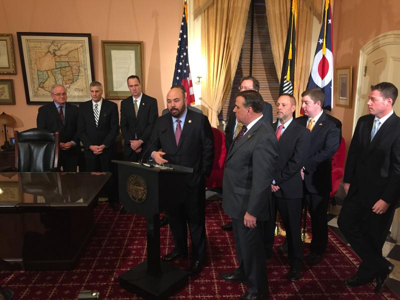 House Republican leaders stand with business and labor representatives announcing working group to reach unemployment compensation plan in December 2016.
