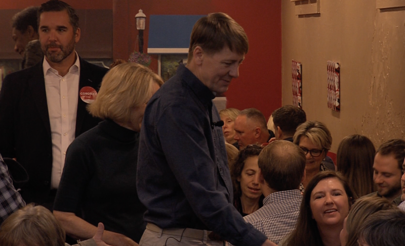 Richard Cordray shakes hands with supporters