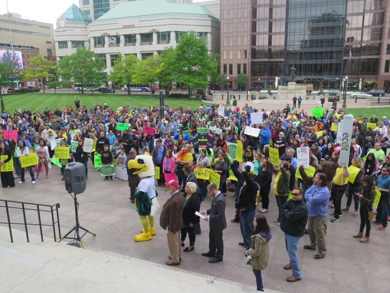 ECOT teachers, staff, families and students - including founder Bill Lager (front, in red hat) - rallied at the Statehouse in May 2017.