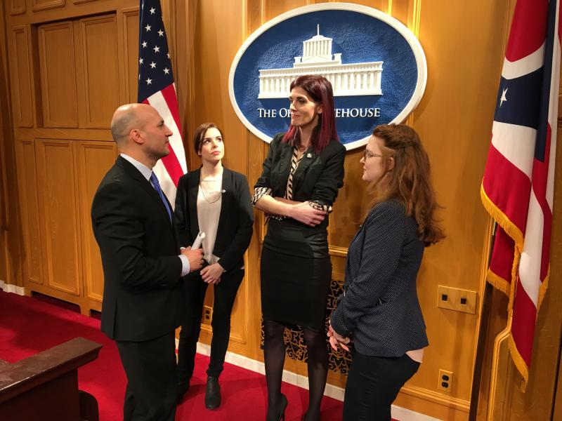 Sen. Joe Schiavoni (D-Boardman) talks with Katelyn Bowden (center), founder of the BADASS Army, along with members Jacklyn Lefevers of Cincinnati and Belinda Berry of Pittsburgh.