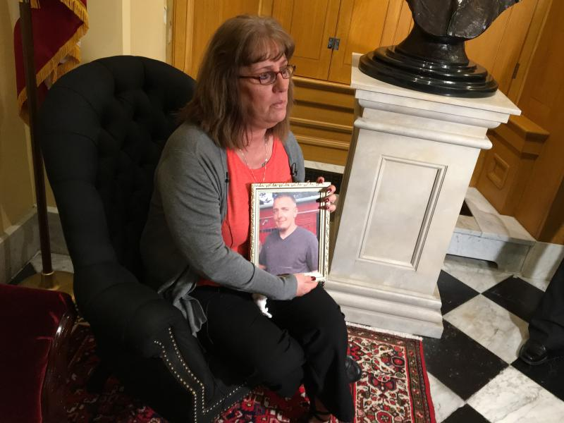 Linda Chambers holds a picture of her son, Scottie Childers, who died of an opioid overdose in January 2017.