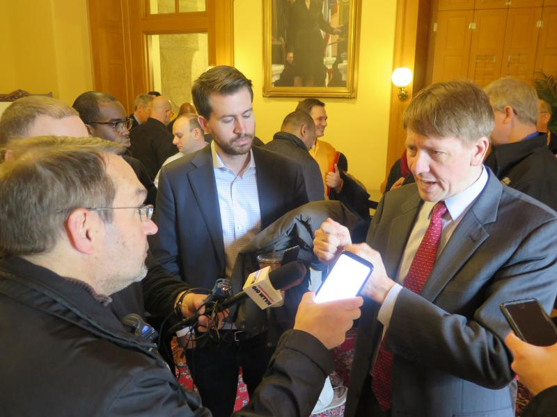 Richard Cordray takes questions from reporters after an event at the Statehouse.