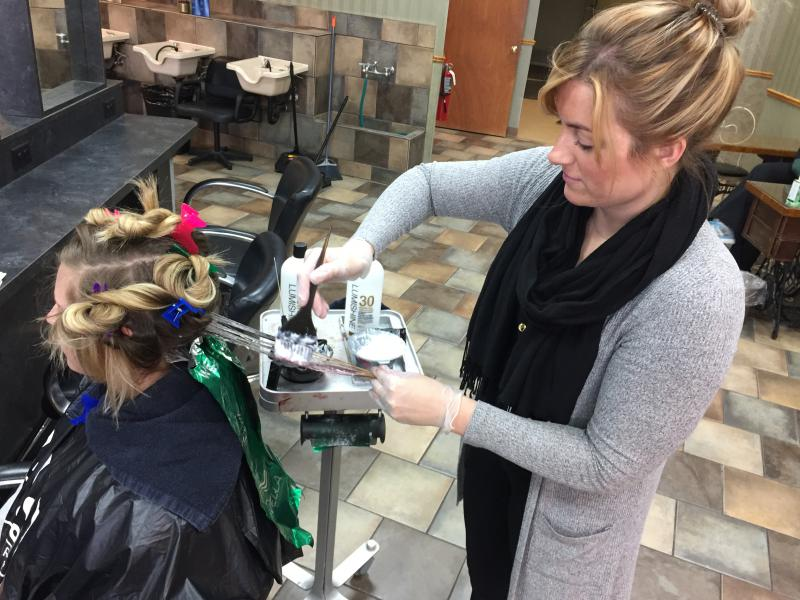 Katie Groezinger, cosmetology student, is 300 hours of instruction away from receiving an advanced cosmetology license. She's coloring her client's hair using a technique known as balayage at The Spa School in Worthington.