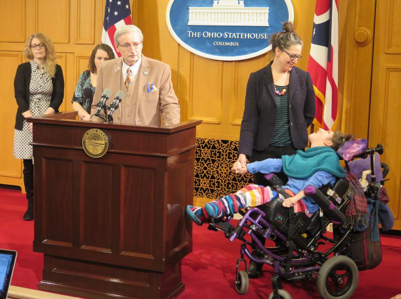 Senate Minority Leader Kenny Yuko (D-Richmond Heights) calls for the medical marijuana program to go forward, alongside Nicole Scholten and her daughter Lucy.